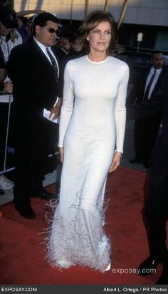 I love this dress white feathered dress on Rene Russo. Feminine, dramatic, gorgeous. It even has my favorite long sleeves!