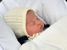 The newborn baby princess is carried in a car seat by her father Prince William from St. Mary's Hospital.
