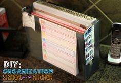 Create an organization station for kitchen countertop to conquer paper clutter