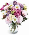 This bouquet of pink alstroemeria, purple lisianthus, white daisies, and other soft blooms arranged in a glass vase expresses your love or friendship. http://www.shalimardesigns.com