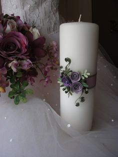 White unity candle paper quilled with shades of lavendar and purple roses