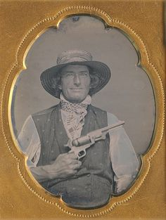 Daguerreotype portrait of an unidentified man posing with a revolver, smiling