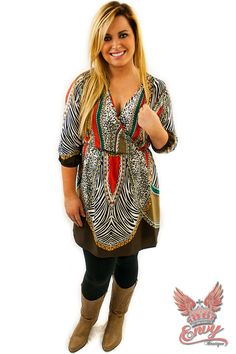 Down to Kenya Dress - Go wild in this adorable multiprinted dress. This chic dress features a modern edgy mixture of animal and tribal prints. It's warm colors make this piece a perfect addition to your fall wardrobe. We love it's deep cut neckline and wrap around effect. Complete your look with a pair of black or brown boots.  | available at http://www.envyboutique.us/shop/kenya-dress/ |  #Envy #Boutique #fashion #fashiontrends