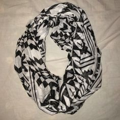 B&W cross infinity scarf Great condition, worn once or twice. Charlotte Russe Accessories Scarves & Wraps