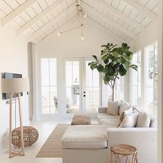 neutral living room decor with modern sectional sofa and rattan pouf fiddle fig and white wood beam cathedral ceiling farmhouse sunroom decor farmhouse bonus room with white walls Home Living Room, Living Room Designs, Living Room Decor, Living Spaces, Apartment Living, Small Living, Modern Living, Home Design, Nordic Design