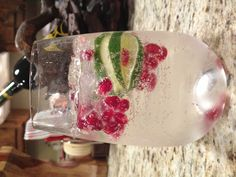 White wine spritzer with lime and pomegranate