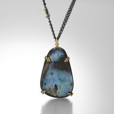 It's easy to get lost in the otherworldly beauty of this Amali necklace.  The one-of-a-kind Boulder Opal is set in an oxidized sterling silver bezel with decorative 18k yellow gold granules, and hangs from an oxidized chain.  The length can be adjusted for easy layering.  Magic and mystery reign in this gorgeous piece. @QUADRUM