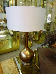 Hammered brass Hollywood Regency table lamp with drum shade.
