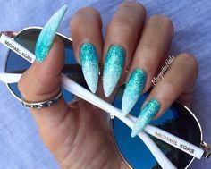White and Aqua sparkle stilleto nails