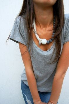 Statement necklace made of rope, cotton fabric yarn, wood, gemstone beads in gray and white colour.