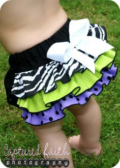 zebra ruffled bloomers...Tara could you make these? My coworker loves them?  There is also a matching bow on the website...