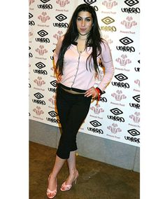 May 8, 2004    ­Amy Winehouse poses backstage during the first day of the the Prince's Trust Urban Music Festival in London.­