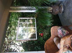 My front porch. Cute use for this beautiful old window!