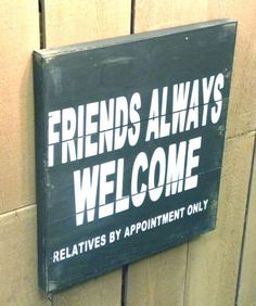 "This humorous wooden pallet sign reads """"Friends Always Welcome"""" in big letters and """"relatives by appointment only"""" in small print. A humorous sign that will make your guests laugh! Made from recla"