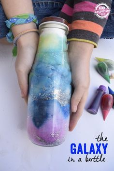 Galaxy Jar (Sensory Bottle) The coolest science experiment ever - the galaxy in a bottle!The coolest science experiment ever - the galaxy in a bottle! Cool Science Experiments, Preschool Science, Science Fair, Science For Kids, Science Projects, Projects For Kids, Activities For Kids, Project Ideas, Fair Projects