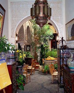 Moroccan Tea House. Must have citrus trees and cool punched-metal lanterns.