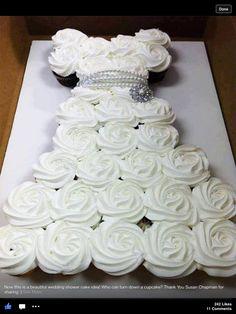 Bridesmaids luncheon? Cute cupcake idea in shape of wedding dress.