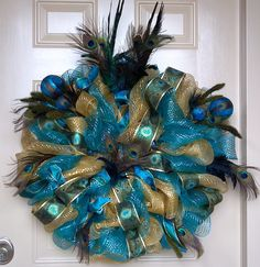 Peacock Wreath.  Peacocks are so popular this year.  This is one of my favorite.  Lady sells them on facebook.com/annabelliesaccessories