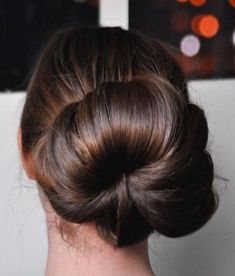 These were ballerinas, who first began to make such hairstyles, as it was comfortable for trainings and looked elegant. Now many girls make their hair like that, a bun is an amazingly elegant hairstyle for every girl, it's very feminine...
