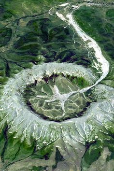 """""""The Kondyor Massif is circular geological formation in Eastern Siberia, Russia, roughly 600 km west-to-southwest of Okhotsk, or some 570 km south-east of Yakutsk. From space it looks like an impact crater or the caldera of an extinct volcano, but Kondyor Massif is neither. It is what geologists refer to as an """"intrusion""""."""