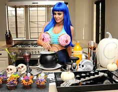 California vixen and hottie, Carmen Electra channeled Katy Perry's sinfully scrumptious cupcake bra and Daisy Dukes with electric blue hair to match.