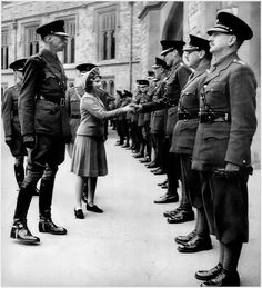 16 year-old Princess Elizabeth being introduced to officers of her regiment in 1942.
