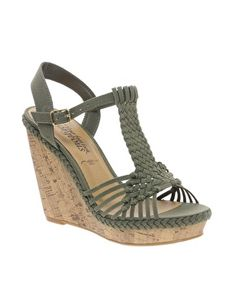 Bring a Boho Woven vibe to your look with these olive wedges