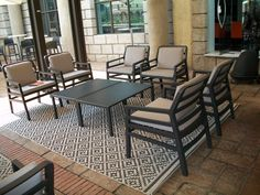 This is the Aria Poltrana lounge set. Anthracite Grey Armchairs with the Tables. Outdoor Furniture Sets, Stackable Chairs, Green Rooms, Upholstered Chairs, Grey Armchair, Furniture, Modular Sofa, School Chairs, Bed Bar