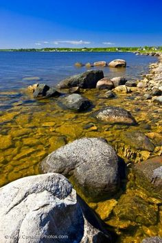 The waters of Lake Winnipeg and the shoreline of Hecla Island are the year-round playground of locals and tourists alike. This rocky shore is situated in the Hecla/Grindstone Provincial Park in Manitoaba, Canada.