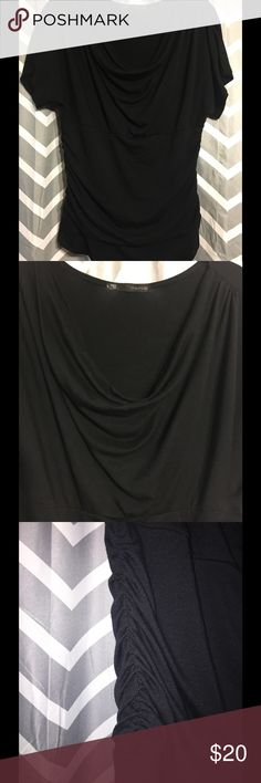 GUC Maurices SS top sz L (wore as 12/14) GUC Maurice's drape neck short sleeve black top with VERY forgiving ruching along the sides.  I wore this shirt as a 12/14.  Looks amazing with jeans for a night out. It's taken me awhile to part with this one, but someone else needs to enjoy it now. Figure flattering ruched sides. Ruched sleeves. Super soft fabric. Perfect for layering. Dress up or down. Style numbers: 31602, 31888, & 26362. Maurices Tops Blouses