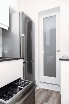 Jennifer's Small Space Kitchen Renovation: The Big Reveal — Renovation Diary The refrigerator was moved to be next to the sink. And there's a dishwasher! The translucent glass sliding door between the kitchen and bathroom brings light into both rooms while still providing privacy for guests.