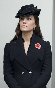 Alexander McQueen coat with poppy at remembrance service 2014