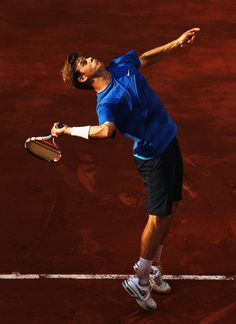 Ryan Harrison Of The USA Serves In The Men's Singles First Round Match Between Gilles Simon Of France And Ryan