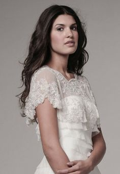 Flourish Beaded Cape is a full circle , beaded caplet that drapes delicately on your shoulders.