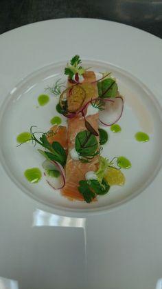 Steal salmon, sour cream, tomato puree with lamb's lettuce lemon