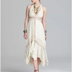 FREE PEOPLE Boho Patchwork Lace Embroidery Beads Beautiful hi-lo dress has an airy patchwork of laces & embroidered gauze. Framed by cross-stitched embroidered bands embellished with beading & sequins. Two buttons close the halter straps, and an embroidered strip down the back adds support. Smocked waist. Lined.  Photos: freepeople.com.  Measurement & Photos Coming (sooner on request) Please Ask any Questions!   Have a Beautiful Day ❤️ Free People Dresses