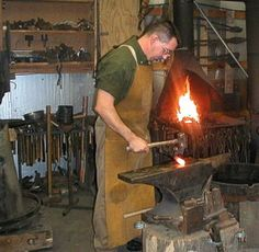 A Forge - the man will use the ANVIL to support the hot metal as he shapes it