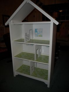 "Make a dollhouse out of book shelves - I'm liking this better than the store bought ones.  Should ""fit"" better in the room also."
