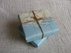 Wouldn't it be fun to surprise your husband with pre-purchased tickets somewhere?  Wrapping them in a map would be perfect.