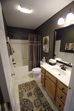 The paint color is from Ace Hardware. Clark & Kensington's Hot Cocoa 3056... same layout as my master bath. I love it... all of it!