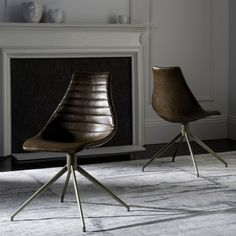 A pairing of retro style and bold contemporary design, this modern swivel chair adds instant character to the living room or home office. Upholstered for extra comfort, designers love its geometric form and dramatic texture paired with sleek brass legs. Swivel Dining Chairs, Modern Swivel Chair, Leather Dining Chairs, Solid Wood Dining Chairs, Dining Chair Set, Metal Chairs, Cool Chairs, Side Chairs, Accent Chair Set