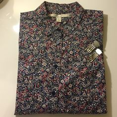 Ditzy Floral Print Button Down Sz small A blue, white, pink, and green ditzy floral print adorn this Buttondown. Shirt is in excellent used condition. Length of shirt measures 25 inches and the bust measures 18.5 inches.  Thank you for stopping by my closet. Lauren Conrad Tops Button Down Shirts