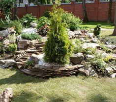 50 DIY Stone flower beds and rock gardens that will boost your garden Stone Flower Beds, Rock Flower Beds, Garden Steps, Garden Edging, Ponds Backyard, Backyard Landscaping, Fairy Garden Pots, Rock Garden Design, Planting Plan