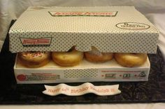 "Replica of a Krispy Kreme box with ""cake carved"" doughnuts. Rectangule cake carved in an angle for the box, the lid and sides are . Krispy Kreme Cake, Crazy Cakes, Fancy Cakes, Mini Cakes, Hamburger Cake, Tiffany Cakes, Dad Cake, Pizza Cake, Doughnut Cake"