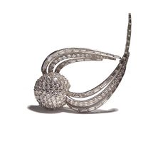 A diamond set comet brooch,  platinum, the plummeting hemispherical comet set with round brilliant cut diamonds, its upwards sweeping tail set with tapering calibre and step cut diamonds, to a galleried mount.  French import marks, circa 1930.