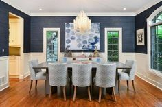 Navy Blue Dining Room Decor Ideas | Domino; Deep navy grasscloth and architectural moldings make for a well-coveted interior.