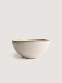 """DESCRIPTIONInspired by a French hot chocolate mug, this hand built  bowl/cup has a milky white glaze and textured chowder finish. Fired with  lead-free and food safe glaze. Due to the handmade nature of each piece, no  two are alike.  DIMENSIONSApprox. 4.75""""w x 2""""h DETAILSMade in New York by Romy Northover"""
