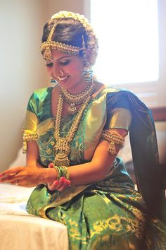 The traditional South Indian bride wears a kanjeevaram silk saree with lots of heavy jewelry. Let's have a look at the various South Indian Brides. Indian Bridal Sarees, South Indian Sarees, Indian Silk Sarees, Indian Bridal Fashion, Indian Bridal Wear, South Indian Weddings, South Indian Bride, India Wedding, Tamil Wedding
