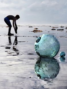 Japanese glass fishing floats. I used to find these on the beach sometimes. They're lovely hanging