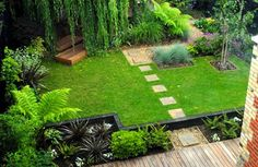 Tiny yard landscaping ideas... we could put the outdoor theatre (shown below somewhere) under the weeping willow...